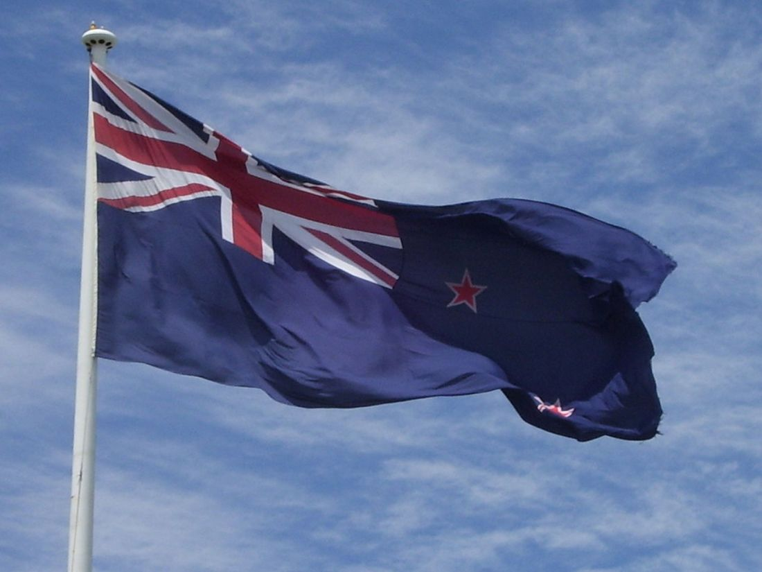 1280px-New_Zealand_flag_at_Auckland_Airport